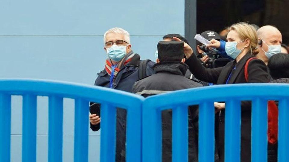 Des inspecteurs l'OMS arrivent enfin sur le marché chinois de Wuhan